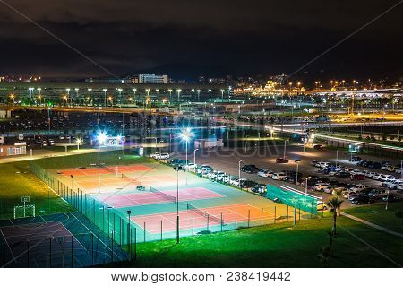 Night Aerial View Of Illuminated Tennis Court, Parking, Streets And Buildings Of Adler, Sochi, Russi
