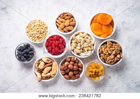 Assortment Of Nuts And Dried Fruits In Bowls. Cashew, Hazelnuts, Walnuts, Almonds, Brazilian Nuts, R
