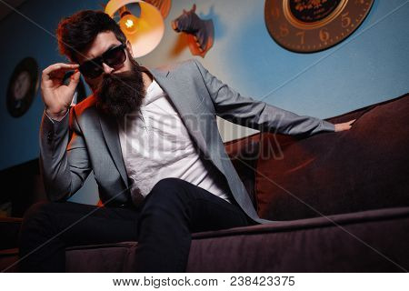 Handsome Hipster Bearded Man In Grey Jacket, White T-shirt And Sunglasses. Cool Young Business Man W