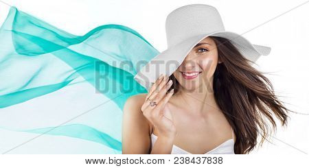 Beautiful woman with long hair in white hat