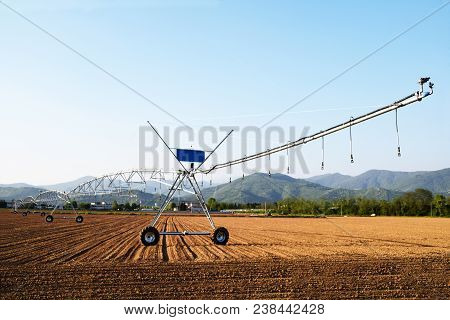 A Giant Spray Sprinkler To Wet A Newly Plowed Field 606