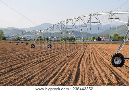 A Giant Spray Sprinkler To Wet A Newly Plowed Field 613