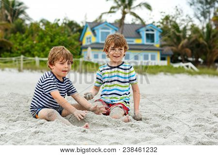 Two Little Kids Boys Having Fun On Tropical Beach, Happy Best Friends Playing, Friendship Concept. S