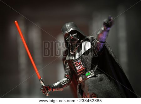 APR 26 2018: Star Wars Sith Lord Darth Vader reaching out to Force Choke while brandishing his lightsaber - Hasbro Black Series action figure