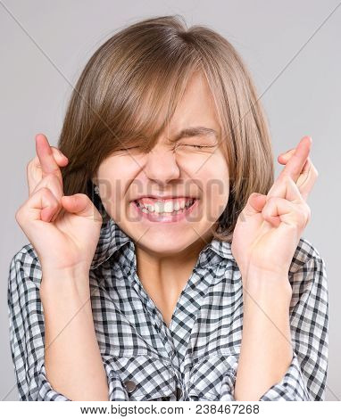 Portrait Attractive Caucasian Hopeful Girl Crossing Her Fingers. Beautiful Human Face Expression And