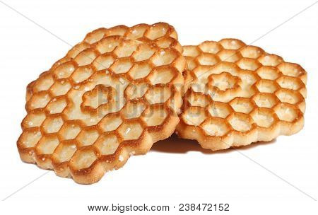 Several Honey Cookies In The Form Of Honeycombs On A White Background