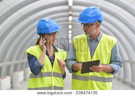 Industrial engineers working together using tablet