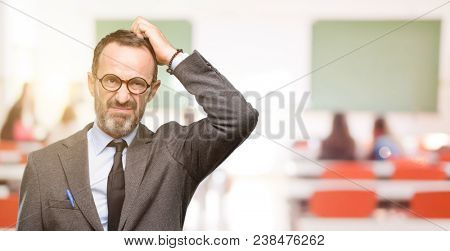 Teacher man using glasses doubt expression, confuse and wonder concept, uncertain future at classroom