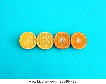 Citrus Fruit Flat Lay Two Halves Of Lemon And Two Halves Of Mandarin Are Lying In A Row On Bright Bl