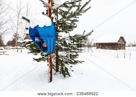 Fedosovo, Russia - February 24, 2018: Outdoor Telephone Kiosk In Snow Field In Village. Working Publ