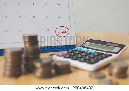 Tax Payment Season And Finance Debt Collection Deadline Concept. Money Coins Stack, Calendar And Cal
