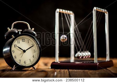 Concept For Timing In Business Teamwork With Newton's Cradle
