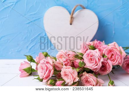 Tender Pink Roses Flowers And White Heart On  Light Blue Textured Background. Floral Still Life.  Se
