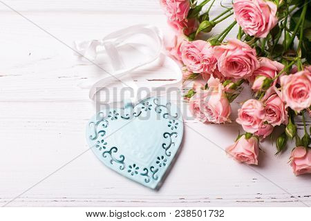 Blue Decorative Heart  And Pink Roses Flowers On White Wooden Background. Floral Still Life.  Select