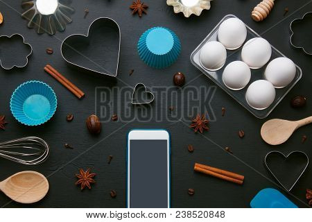 Baking Background With Eggs And Kitchen Tools: Rolling Pin, Wooden Spoons, Whisk, Sieve, Bakeware, S