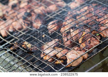 Cooking Chicken Grilled On The Grill. Grill The Fillets On The Grill Over The Coals Of The Close-up