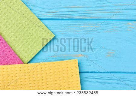 Kitchen Napkins On Blue Wooden Background. Cellulose Rags For Washing Dish On Textured Woooden Table