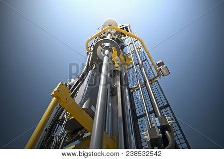 Hydraulic crawler drill machine against blue sky. poster