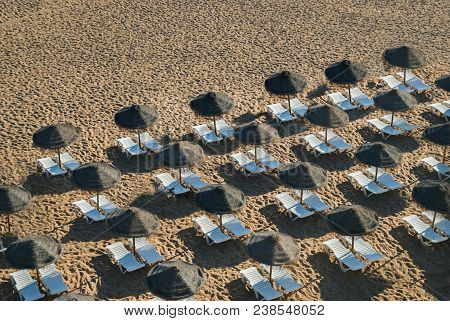 A Lot Of Lounges At Sunny Beach In Holyday. Bright Lounge In Sand