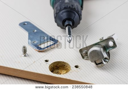 Assembly Of Hinges In A Carpentry Workshop. Joinery Accessories In A Carpentry Workshop On A Wooden