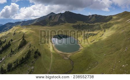 Drone view of Lac de Roy in the French Alps with beautiful lake and landscape