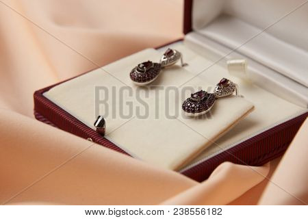 Pair Of Ruby Diamond Earrings In Jewelry Box, Close-up. Beautiful Luxury Brilliant Jewelry