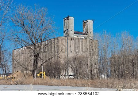 Abandoned Grain Elevator Against Blue Sky In Minneapolis Minnesota Hennepin County