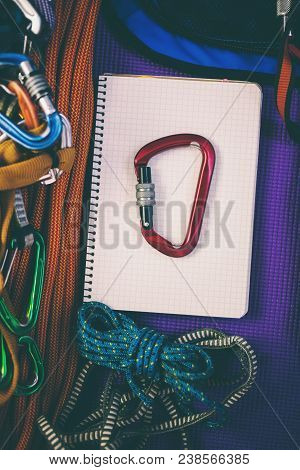 Notepad, Rope And Carbine.