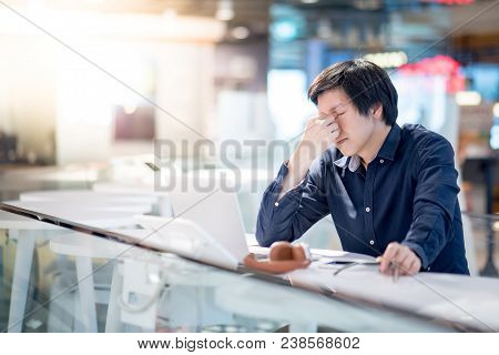 Young Asian Business Man Feeling Stressed And Frustrated While Working With Laptop Computer. Male En