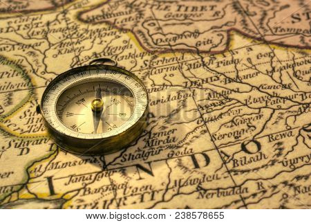 Old Compass And Map Of Northern India Close To Border With Pakistan.