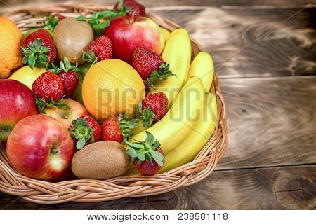Fruits Are Represented In Healthy Eating - Tasty And Juicy Fruit In A Wicker Basket Basket