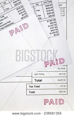 Paid Invoices - Three Invoices For Several Thousand Dollars, All Stamped Paid.
