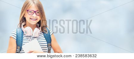 Portrait Of Modern Happy Teen School Girl With Bag Backpackand On Blurred Background.