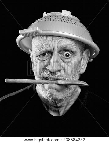 Dramatic Black And White Portrait Of A Mad Man With A Plastic Strainer On The Head