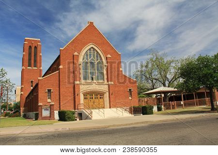 Red Brick Exterior Of Grace Evangelical Lutheran Church In Tucson, Arizona With Blue Sky Copy Space,