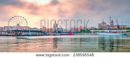 Malaga, Spain - April 26, 2018. Malaga Port Panorama With Ferris Wheel And Saiiling Cruise Ship Sea