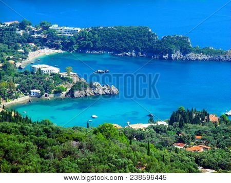 Heart-shaped Bay, Romantic, Paleokastrica Beach On Corfu Kerkyra, Greece. Ionian Sea. Bay With Cryst