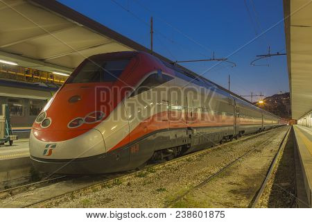Trieste, Italy - April 27, 2018: Modern High-speed Passenger Train Stand On Main Railways Station In