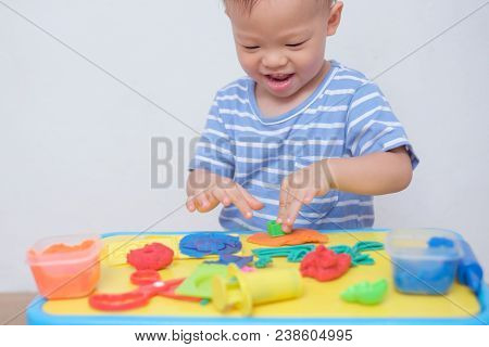 Cute Smiling Little Asian 18 Months Old Toddler Baby Boy Child Having Fun Playing Modeling Clay / Pl