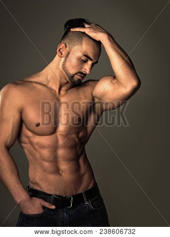 Dieting And Fitness. Sport And Workout. Athletic Bodybuilder Man On Grey Background. Man With Muscul