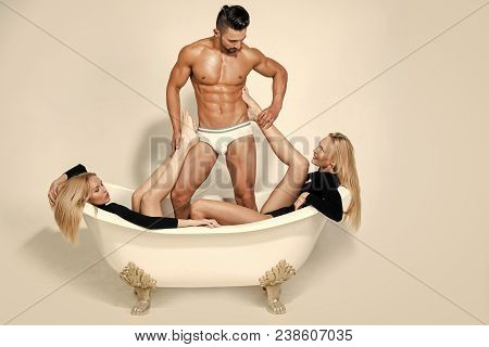 Relax, Spa, Bathroom, Bodycare. Family, Polygamy, Betrayal. Man With Muscular Body, Twin Women In Ba