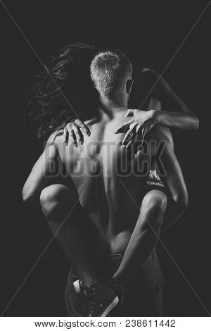 Naked Couple Of Sexy Woman In Red Trainers Sitting On Man With Strong Muscular Body Standing With Ba
