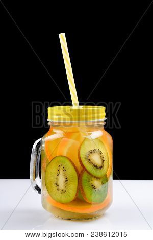 Infused Water With Kiwi And Orange In Jars