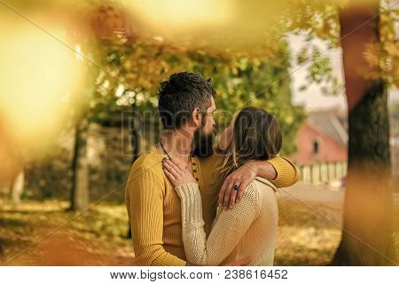 Couple In Love. Love Relationship And Romance. Man And Woman At Yellow Tree Leaves. Autumn Happy Cou