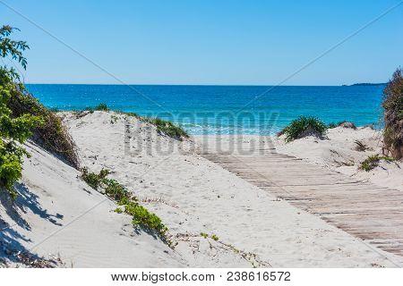 Boardwalk And White Sand In Alghero Shoreline. Sardinia, Italy