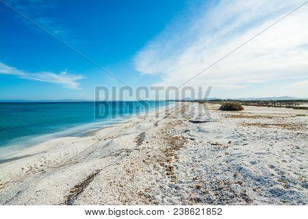 White Pebbles In Stintino Shoreline. Sardinia, Italy