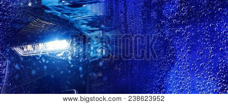 Modern Car Wash Banner Concept Background With Car In The Automatic Brush Washer. Deep Blue Color Gr