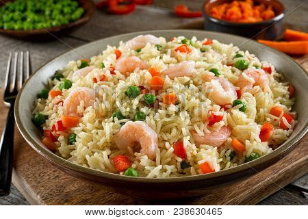 Delicious Shrimp And Vegatable Rice Pilaf With Green Peas, Carrots And Red Peppers.
