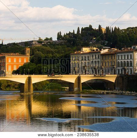 Sunlit Bridge At Florence, Italy With Cypress Trees In The Background.