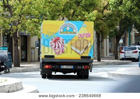 Menton, France - April 5, 2018: Italian Ice Cream Truck (iveco Daily) Driving On The Road In The Cit